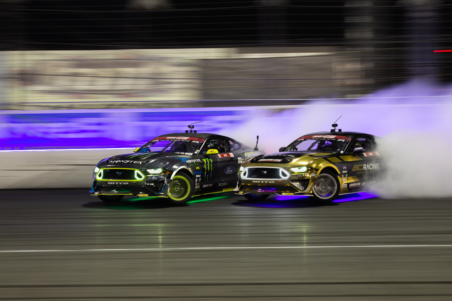 Vaughn Gittin Jr. leads Chelsea Denofa at Irwindale Speedway. Photo by Togue Culture.
